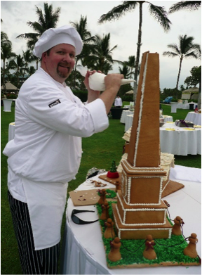 Chef posing with desserts
