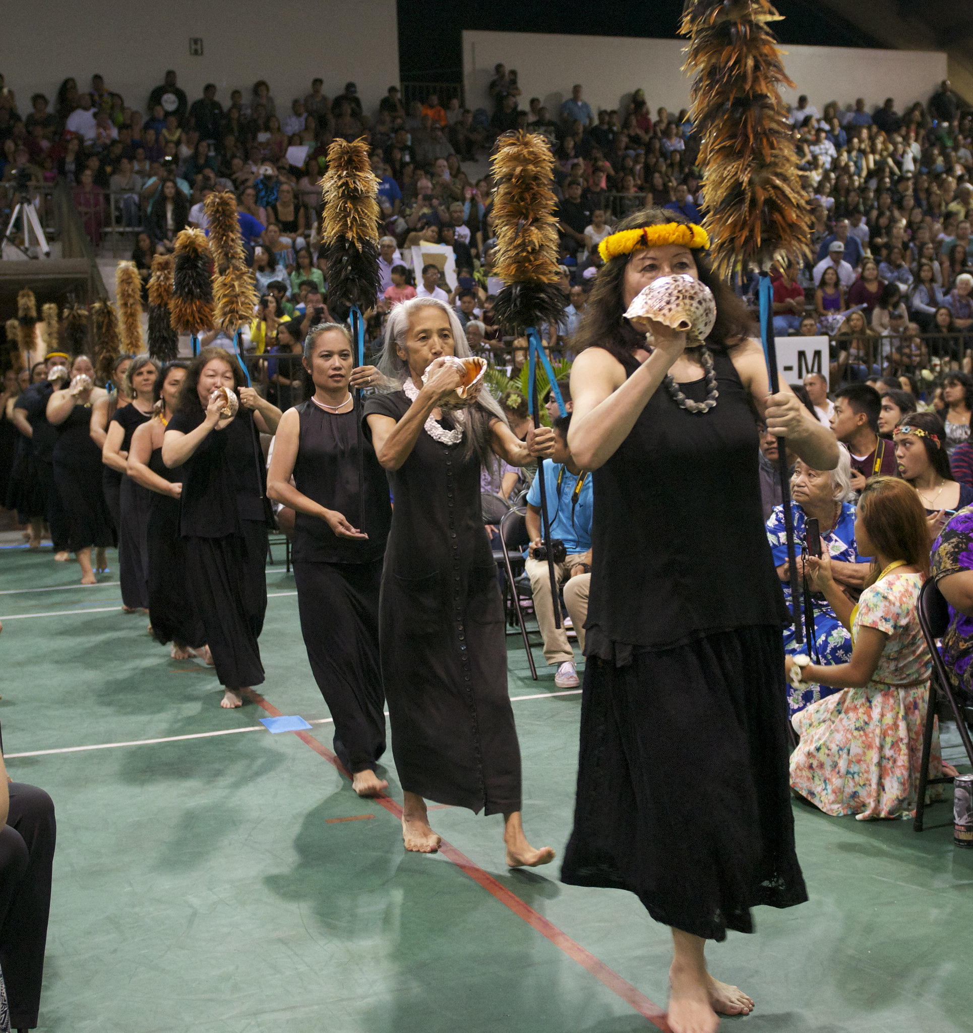 Trina Nahm-Mijo was in the first cohort of the Kūkū`enas, a mixed group of faculty, staff, and students started by Dr. Taupōouri Tangarō in 2009 to assist in Hawaiian protocols like Kīpaepae, pictured here at 2016 Hawai'i CC Graduation.
