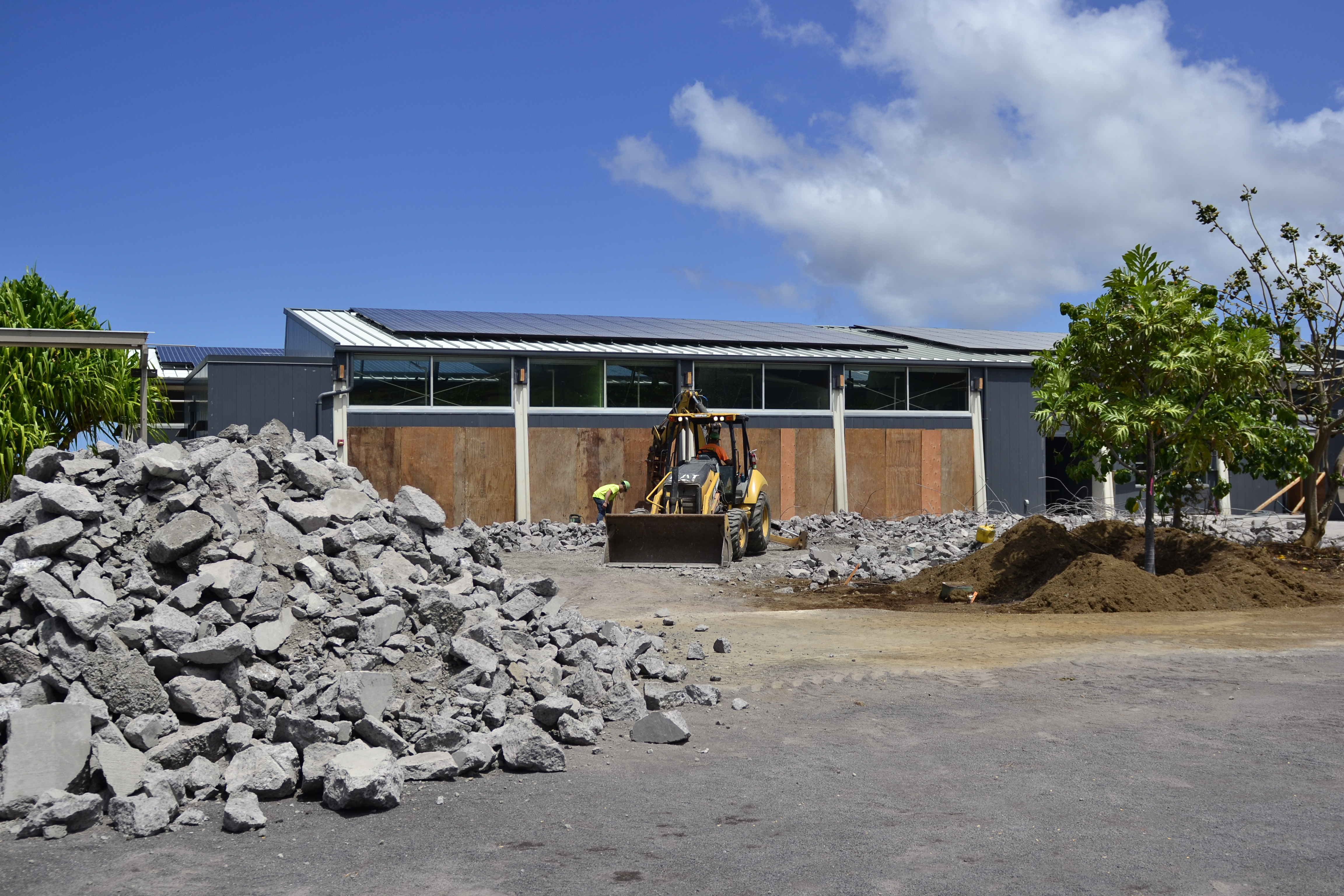 Construction workers at work on a project in April 2021 to create a large lanai area that will be a multi-functional space when it's complete next year.