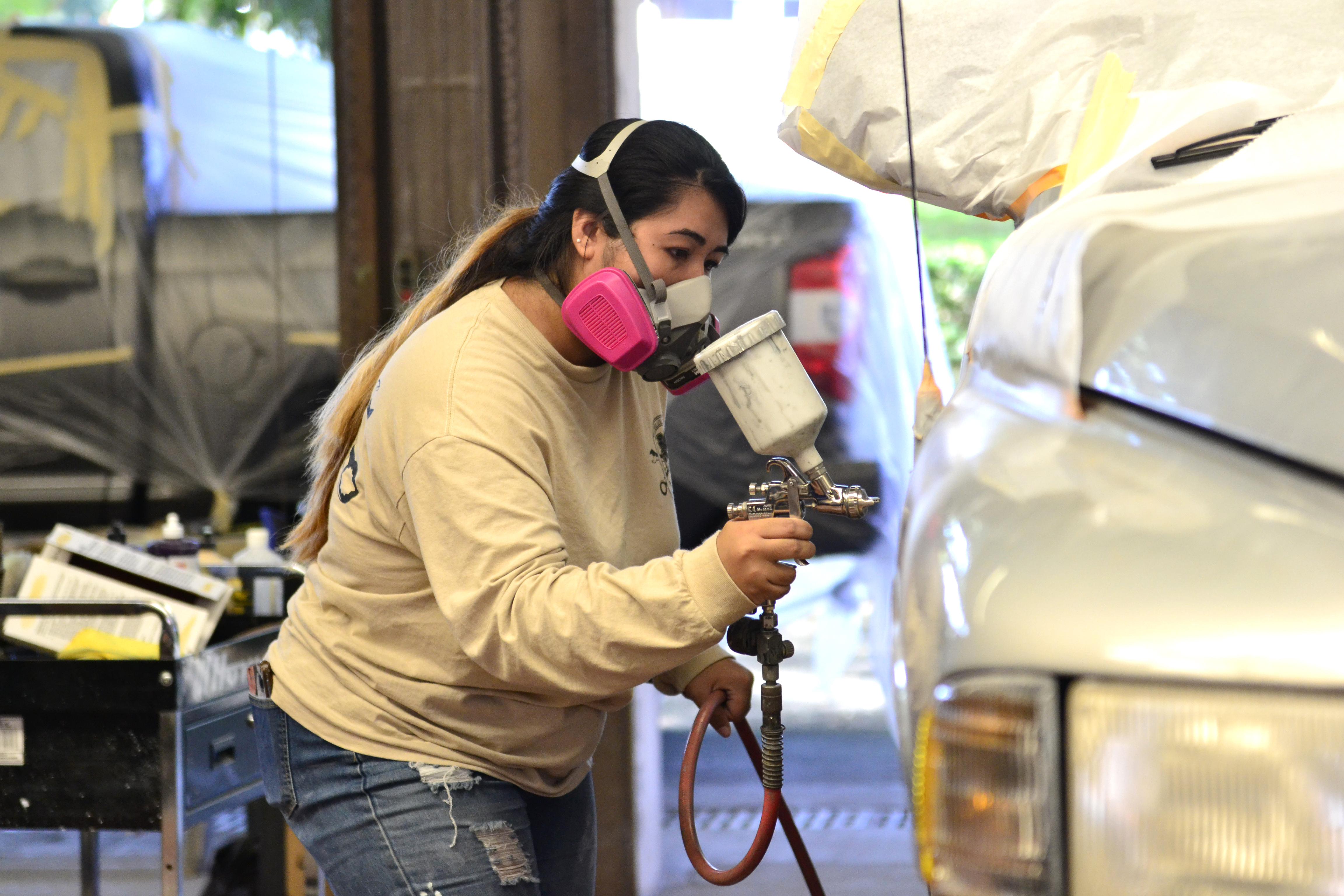 Shanaya Astrande at work in the Auto Body Repair and Painting shop in Hilo.