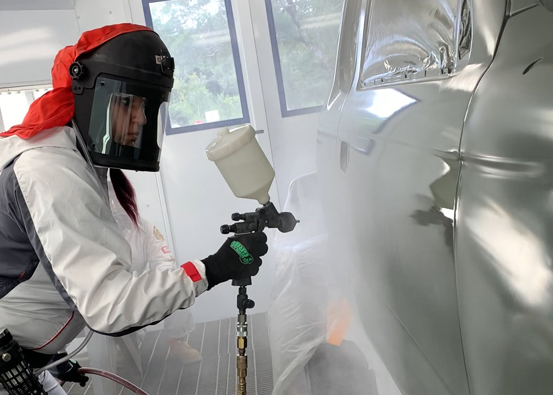 Billie Martines at work in the spray booth at the ABRP shop in Hilo.