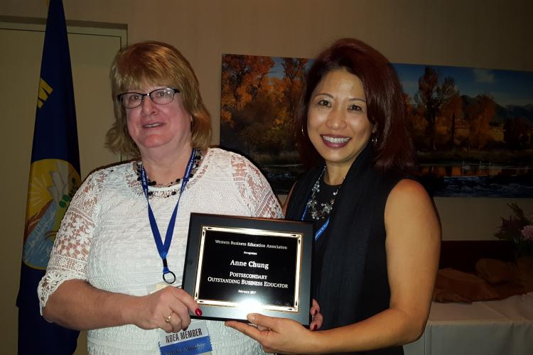 Anne Chung, right, receiving her award at the WBEA conference in Bozeman. Presenting the award is Elaine Stedman, WBEA President.