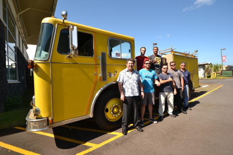 Students in the Fire Science and Diesel Mechanics programs posing by fire truck
